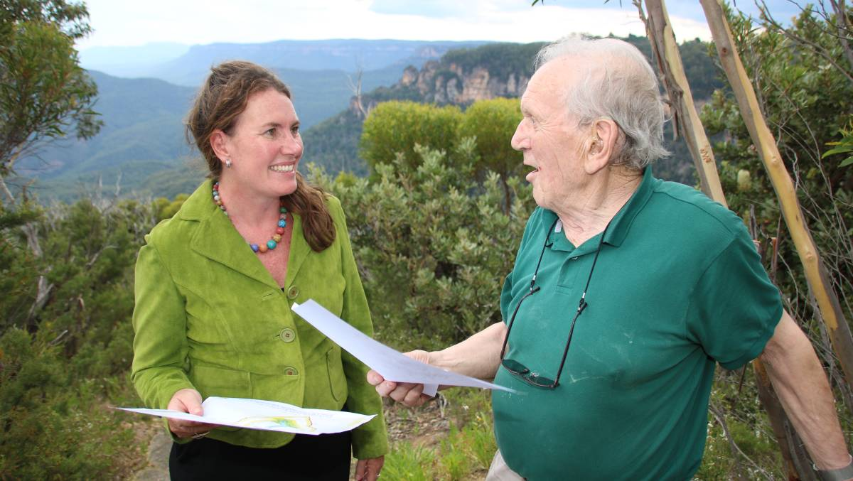 Blue Mountains MP, Trish Doyle, with Leura Bushcare worker and cliff top walk advocate, Norm Harris, near Olympian Rock at Leura.