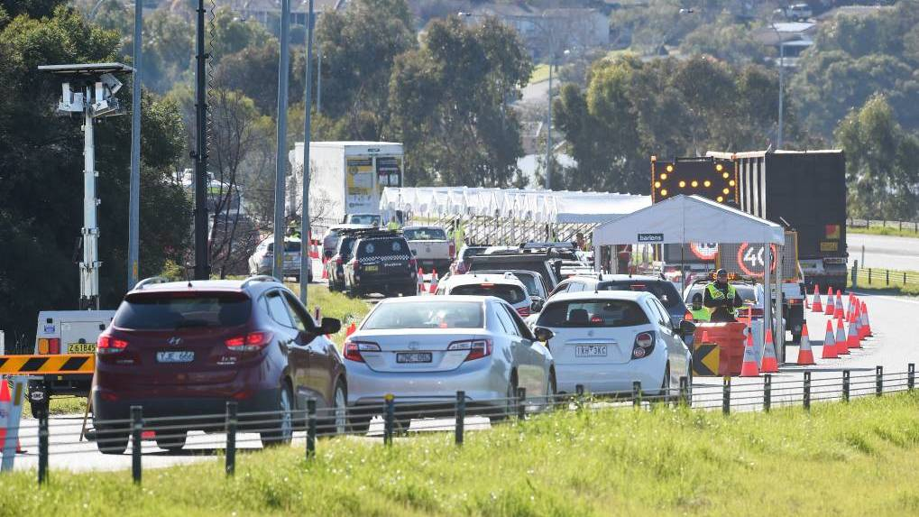 LINE UP: Police and soldiers at the Hume Highway checkpoint in Albury. Picture: Border Mail