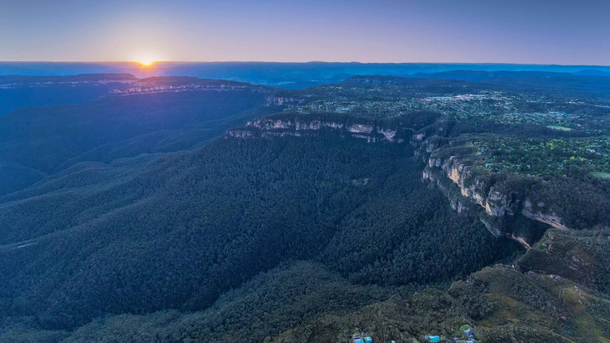 Sun setting over Katoomba and the World Heritage listed Blue Mountains National Park Photo: Destination NSW