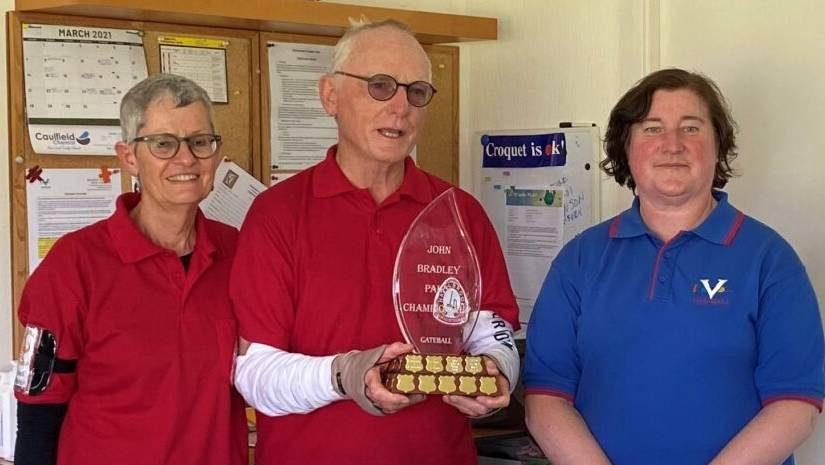 Hazelbrook Gateballers, Penny and John Park, third time winners of the Victorian State Gateball Championship, being presented with the 2021 Trophy by Elaine Cloverdale of Victoria.