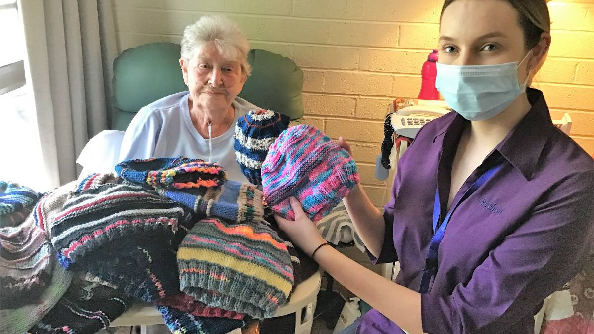 One thousand beanies later: Springwood's Nelda Kavanagh has been hard at work during COVID. Pictured with Talisa Rollins. Photo: Peter Kemp.