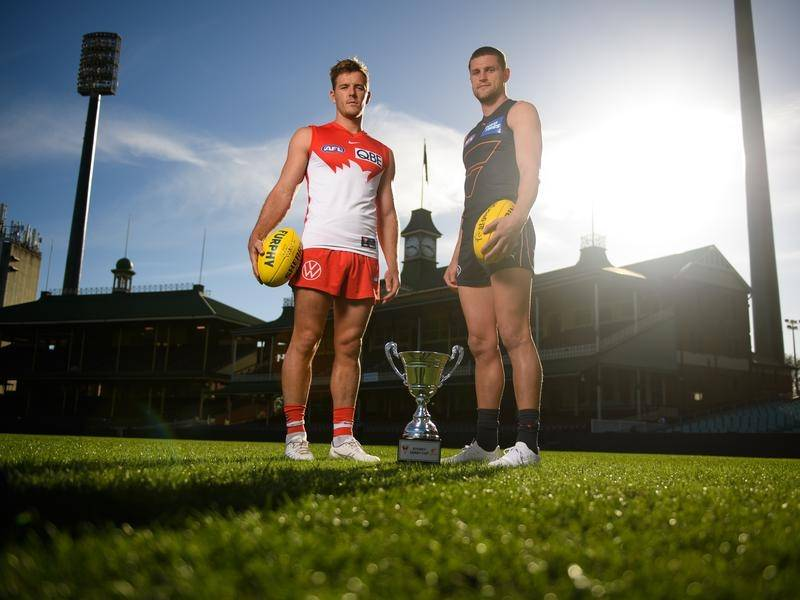 Luke Parker of the Swans and Jacob Hopper of the Giants pose ahead of their AFL clash on Saturday.