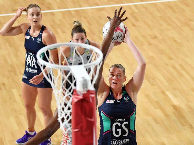 Melbourne Vixens have pulled clear late in a Super Netball win over Victorian rivals Collingwood.