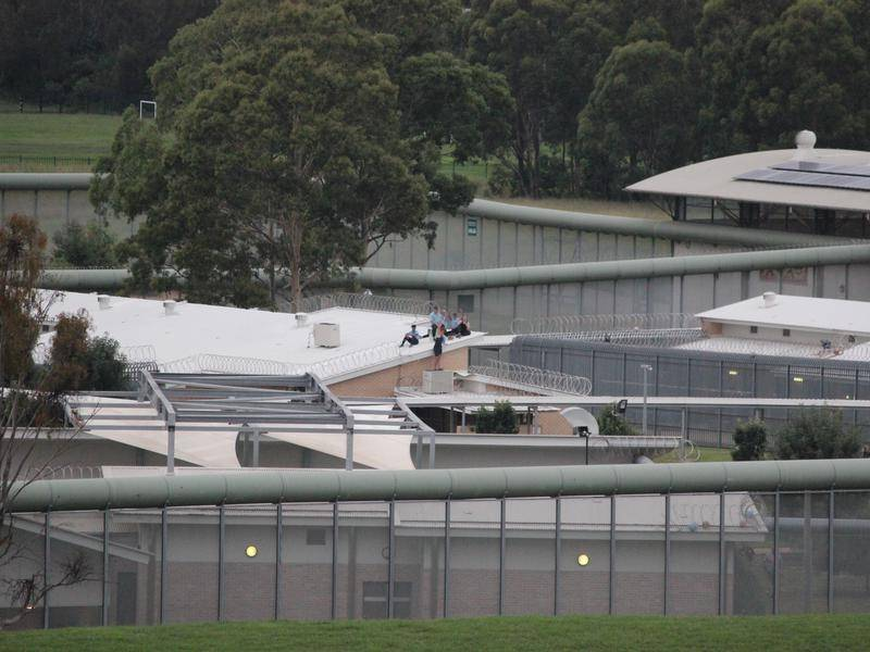 Detainees at a Sydney youth justice centre have scaled a roof and remain there hours later.