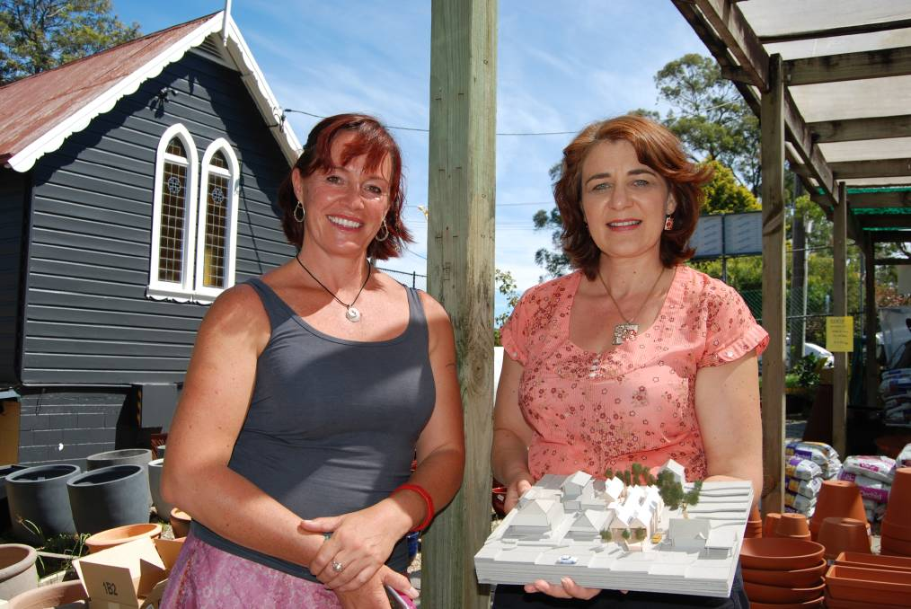 Glenbrook resident Sarah Carter and Blaxland-based architectural designer Lara Begg at 18/18A Ross Street, Glenbrook last Friday with a model of the proposed new shops and offices.